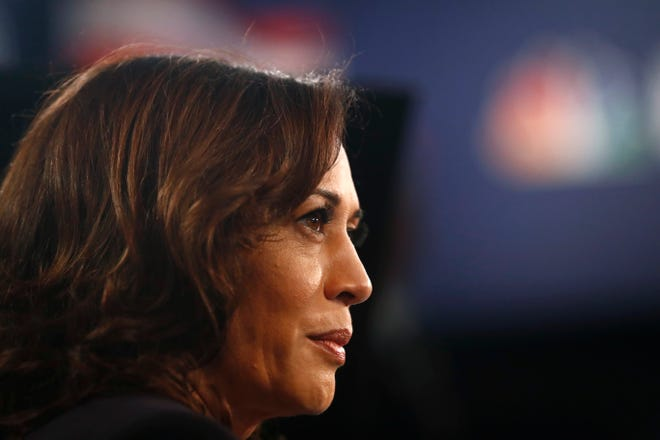 Democratic presidential candidate Sen. Kamala Harris, D-Calif., listens to questions in the spin room after the Democratic primary debate hosted by NBC News at the Adrienne Arsht Center for the Performing Art, Thursday, June 27, 2019, in Miami.