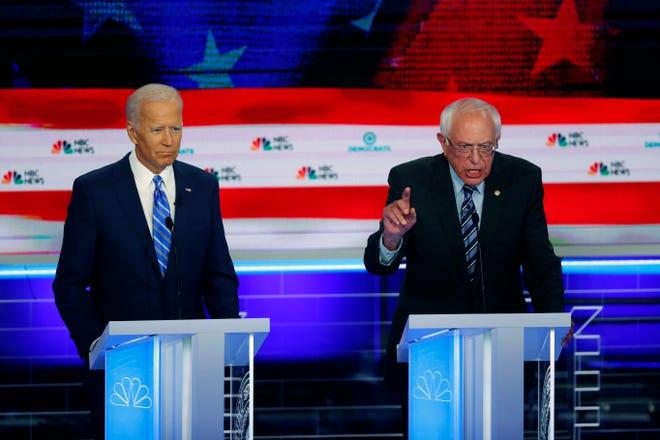 Democratic presidential candidate Sen. Bernie Sanders, I-Vt., right, speaks during the debate as former vice president Joe Biden listens.