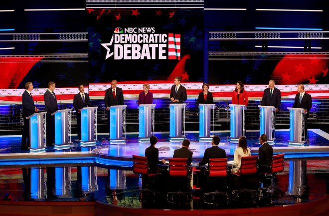 Democratic presidential candidates, left to right, Democratic presidential candidate New York City Mayor, Bill de Blasio, . Rep. Tim Ryan D-OH, former Housing Sec. Julian Castro, Sen. Cory Booker D-NJ., Sen. Elizabeth Warren, D-Mass., former Rep. Beto O'Rourke, D-Tex., Sen. Amy Klobuchar, D-MN. , Rep. Tulsi Gabbard, D-HI., Washington Gov. Jay Inslee, and former U.S. Rep. John Delaney (MD), listen to a question during the Democratic primary debate hosted by NBC News at the Adrienne Arsht Center for the Performing Art, Wednesday, June 26, 2019, in Miami.