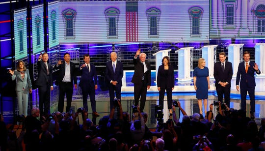 Democratic presidential candidates from left, author Marianne Williamson, former Colorado Gov. John Hickenlooper, entrepreneur Andrew Yang, South Bend Mayor Pete Buttigieg, former Vice-President Joe Biden, Sen. Bernie Sanders, I-Vt., Sen. Kamala Harris, D-Calif., Sen. Kristen Gillibrand, D-N.Y., former Colorado Sen. Michael Bennet and Rep. Eric Swalwell, D-Calif., wave as they enter the stage for the second night of the Democratic primary debate hosted by NBC News.