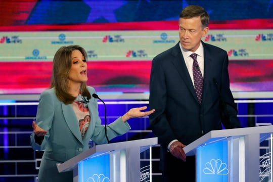 Democratic presidential candidate author Marianne Williamson speaks  as former Colorado Gov. John Hickenlooper listens.