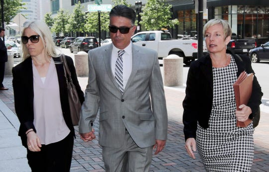 Former USC women's soccer coach Ali Khosroshahin, center, arrives at federal court Thursday, June 27, 2019.