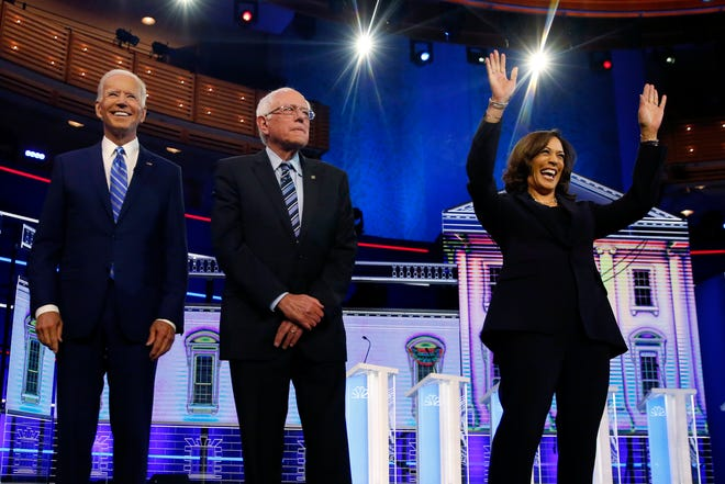 Democratic presidential candidates former vice president Joe Biden, left, Sen. Bernie Sanders, I-Vt., and Sen. Kamala Harris, D-Calif., pause for a photo op before the start of the primary debate hosted by NBC News at the Adrienne Arsht Center for the Performing Arts, Wednesday, June 27, 2019, in Miami.