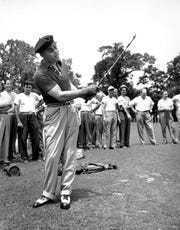 Former boxer Joe Louis pitches from the fairway of the Engineers Club in Roslyn, N.Y. on June 26, 1940. Louis played golf the day after his victory fight with Joe Walcott, which he announced as his last fight.