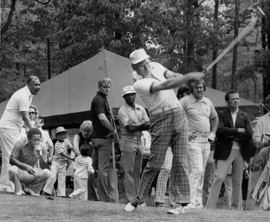 Joe Louis, far left, plays golf with Gerald Ford in 1975. Kneeling in front of Louis is  actor/comedian Flip Wilson.
