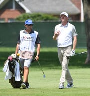 Nate Lashley talks with caddie Ricky Romano on the 12th fairway during the second round of the Rocket Mortgage Classic.