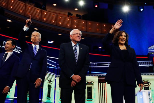 Democratic presidential candidates, from left, South Bend Mayor Pete Buttigieg, former vice president Joe Biden, Sen. Bernie Sanders, I-Vt., and Sen. Kamala Harris, D-Calif., gesture before the start.