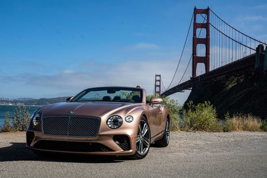 The 2020 Bentley Continental GT V8 convertible poses near San Francisco's Golden Gate bridge.