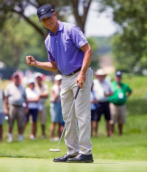David Toms reacts after sinking a birdie putt on his final hole during the opening round of the U. S. Senior Open on Thursday.