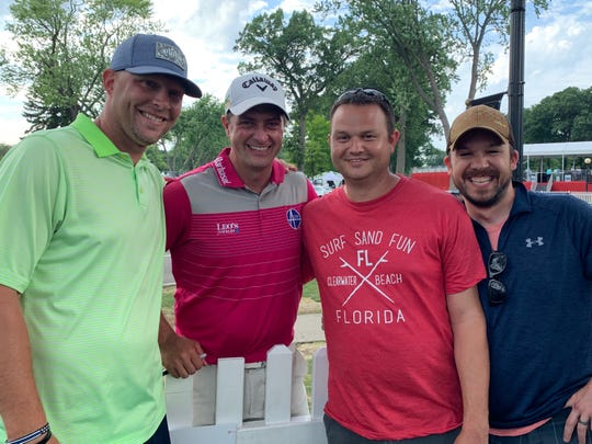 From left, Dustin Nall, Brian Stuard, D.J. Heselschwerdt and McKenna Long pose for a picture following Friday's second round at the Rocket Mortgage Classic.