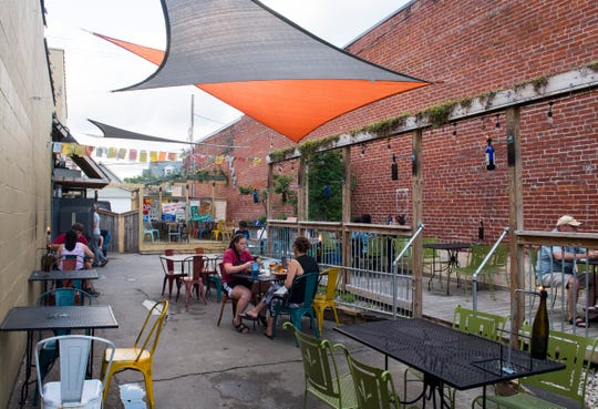 Dinners relax on the patio at Franklin Street Pizza Factory Thursday, May 30, 2019.