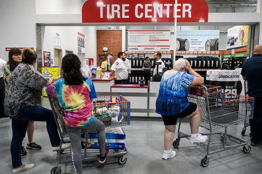 A large line for customer service snakes by the Tire Center during the grand opening of Costco located on the east side of Evansville, Friday, June 28, 2019.