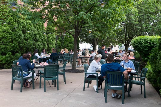 Customers dine on the patio of Smitty's Italian Steakhouse on Franklin Street, Thursday, May 30, 2019.