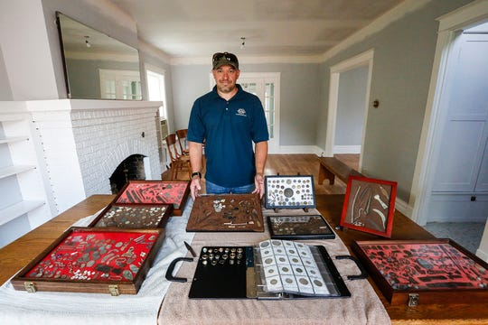 John Ruth stands with a collection of items he found with his metal detector over the years. Doug Raflik/USA TODAY NETWORK-Wisconsin