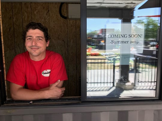 Menyus Borocz standing inside the future new La Piadina location in Old Town's The Exchage.
