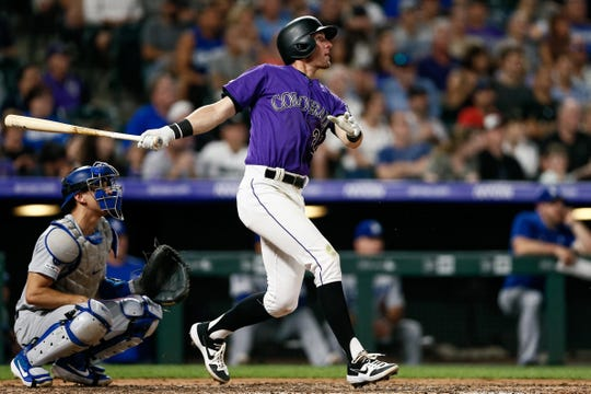 Ryan McMahon of the Colorado Rockies watches the flight of his solo home run in the seventh inning of Thursday night's game against the Los Angeles Dodgers at Coors Field in Denver. The Rockies and Dodgers will wrap up their four-game series in Denver with games at 6:10 p.m. Saturday and 1:10 p.m. Sunday.