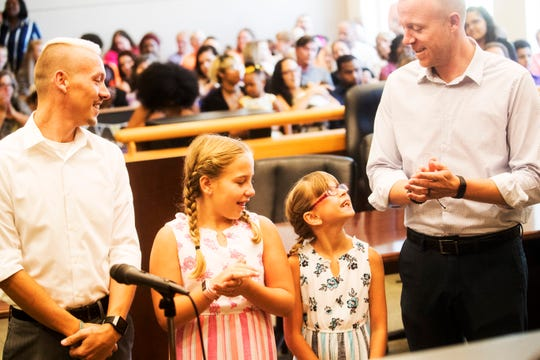Naples residents Justin Grant-Wright, left, and Phillip Wright-Grant adopted Alexis Wright-Grant at the Lee County Courthouse on Friday June, 28, 2019. Pictured with them is their daughter, Brooklyn Wright. They took part with other families in mass adoption ceremony.