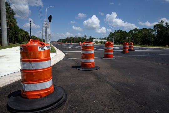 Traffic barrels block off a new turning lane at Griffin Drive on Friday, June 28, 2019, in Lehigh.