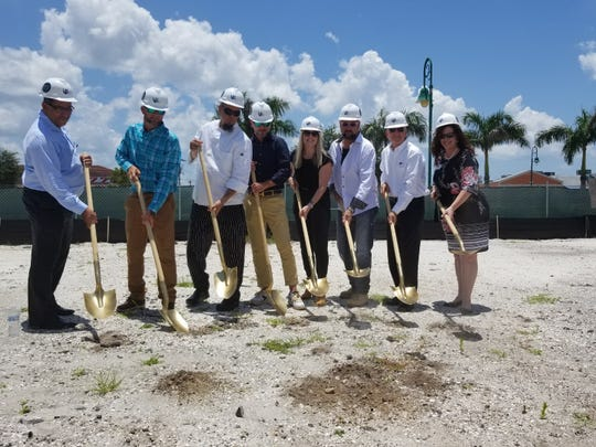 George Lukas, third from right, and his team celebrate the forthcoming groundbreaking of a new steakhouse and skybar in Cape Coral.