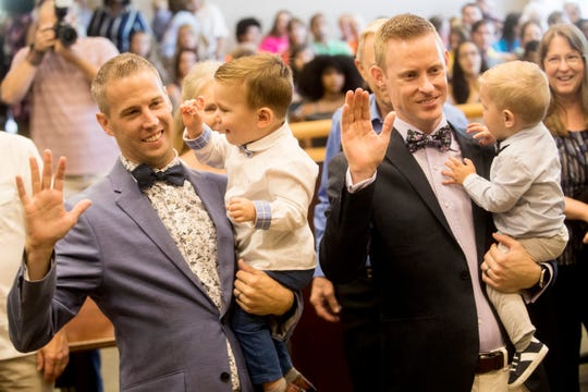 Daniel Selvey Shaw, left,  and Derrick Selvey Shaw adopted Jordan, 2, and Jase,1, at the Lee County Courthouse on Friday June, 28, 2019. The family took part in a mass adoption with other families.