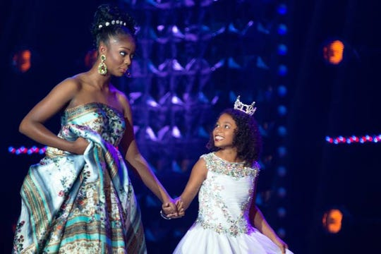 Miss Garden City Teen Zaria Sumpter shares a mischievous look with her princess after the question portion of the evening on Wednesday, June 26. Each competitor is assigned a mentee, or princess, to spend time with throughout competition season.