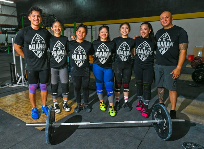 Members of Guahan Weightlifting team gather at the Chamorri CrossFit gym in Tamuning on Thursday, June 27, 2019. From left, David Bautista, Dayamaya Calma, Jacinta Sumagaysay, Dayanara Calma, Dayalani Calma, Armie Almazan and coach Edgar Molinos. The team hopes to carry home gold medals after their participation in the 2019 Pacific Games, scheduled to be held at Samoa in July.