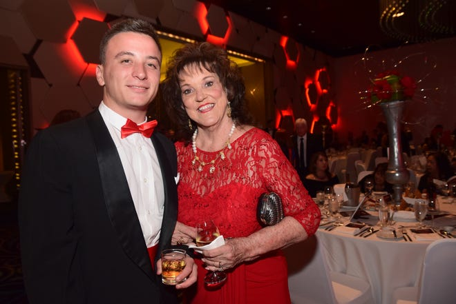 Margaret Jones with grandson Kai Murrell at the 16th Annual 'Wrapped in Red' Red Ball at the Dusit Thani Hotel on Sept. 17, 2016.