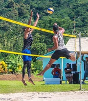 Beach volleyball players test out the venue at the Scientific Research Organisation of Samoa.
