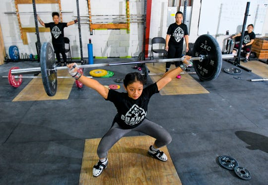 Athlete Dayamaya Calma, front, trains with other team members at the Chamorri CrossFit gym in Tamuning on Thursday, June 27, 2019. Calma plans to represent Guam in the 49 kg body weight catagory when she competes in the 2019 Pacific Games at Samoa in July.