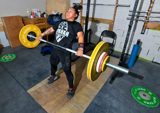 Weightlifting team member, Jacinta Sumagaysay, executes a lift during a training session at the Chamorri CrossFit gym in Tamuning on Thursday, June 27, 2019. Sumagaysay plans to represent Guam in the 55 kg body weight catagory when she competes in the 2019 Pacific Games at Samoa in July.