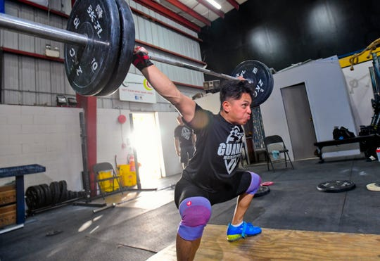 Weightlifting team member, David Bautista, commits to a lift during a training session at the Chamorri CrossFit gym in Tamuning on Thursday, June 27, 2019. Bautista plans to represent Guam in the 73 kg body weight catagory when he competes in the 2019 Pacific Games at Samoa in July.