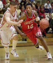 Lafayette Jeff's Peyton Stovall gets around Harrison's Zach Schwartz during the Logansport Sectional Championship game at the Jeff won last Saturday.