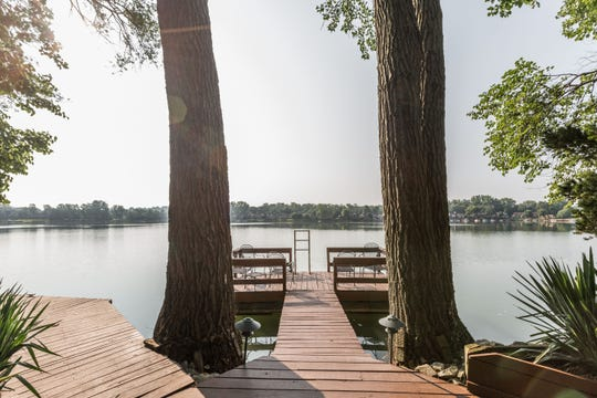 Two trees frame the path to Lake Kesslerwood from the home at 4957 Fall Creek Road.