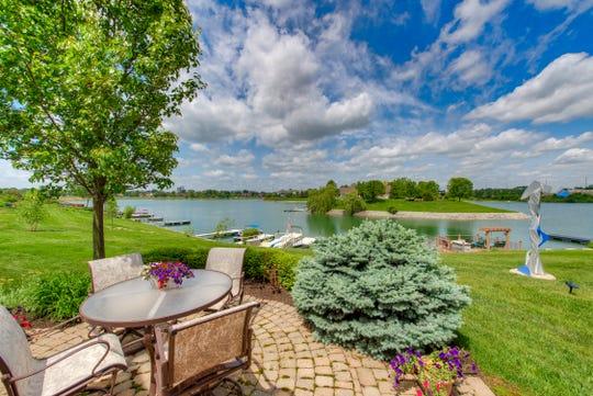 The backyard at 9242 Crystal River Drive has a serene view of Crystal Lake.