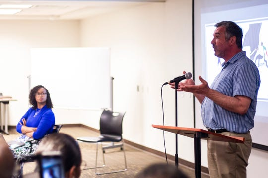 Newman Abuissa, transportation engineer and Democratic candidate for Iowa's second Congressional District, speaks during an event hosted by Iowans for a Democratic Sudan, Thursday, June 27, 2019, at the Public Library in Coralville, Iowa.