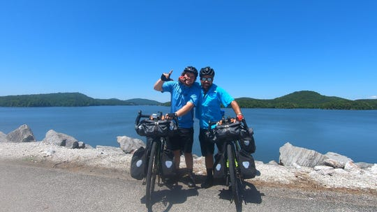 On their way to Vancouver, British Columbia, from Key West, Florida, Jacob and Joshua Wall take a moment next to a lake in Alabama near Talladega.