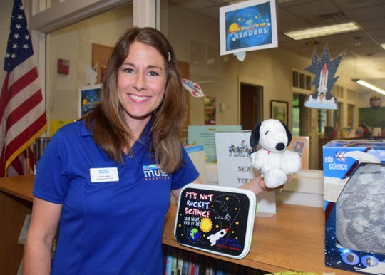 Cindy Mize, outreach educator for the The Muse Knoxville, gives a look at Apollo 10 and Apollo 11 to kids at Karns Branch Library Thursday, June 20.