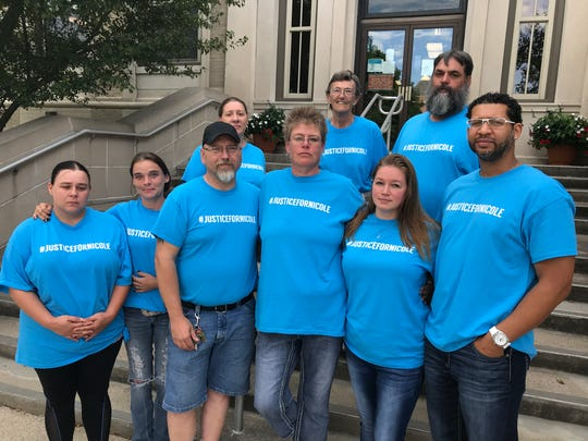 Family and friends of Nicole Bowen, a West Lafayette mother of two who was killed in March near Kentland, came to the Newton County Courthouse wearing shirts that said read #justicefornicole. Among those there for hearings connected to Bowen's death were, from left, bottom row: Nikki Wall, Bridget Goodnight, Mark Samuels, Britteny Bell and Charles Bell; and back row from left, Jessica Corbin, Mary Lou Corbin and Andy Corbin.