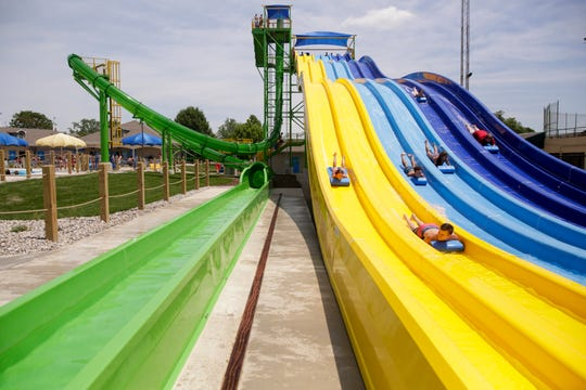 The new water slides at Tropicanoe Cove, the mat racer slide, right and the aqua loop, left, Friday, June 28, 2019 at Columbian Park in Lafayette.