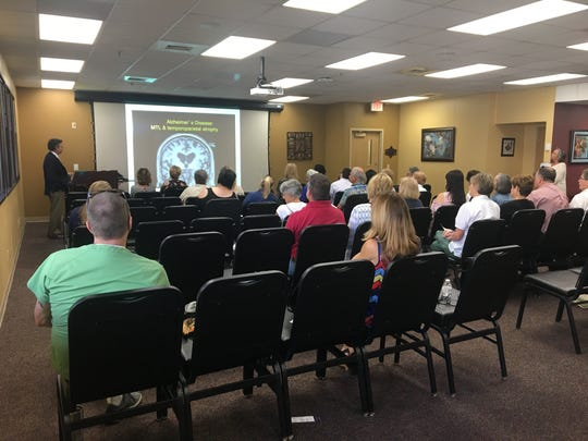 Dr. Kevin Hargrave gave a presentation on the disease. About 40 people showed up to learn more about Alzheimer's and the options available in Acadiana.