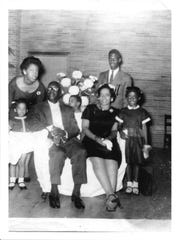 The Rev. Kevin Cosby's family in the chapel of St. Stephen Baptist Church in 1959, including his grandfather, B.J. Miller Sr., who integrated Southern Seminary along with two other Simmons College students in 1951. Cosby is the child in the center of the photo looking over his grandfather's shoulder. He also is a Southern Seminary graduate and is the 13th president of Simmons College.