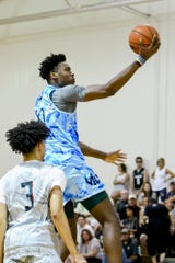 Julius Marble scores during a Moneyball Pro-Am game on June 27.