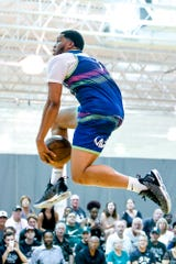 Former Spartan and current Charlotte Hornet Miles Bridges goes between his legs on a dunk during a Moneyball Pro-Am game on Thursday, June 27, 2019, at Aim High Sports in Dimondale.