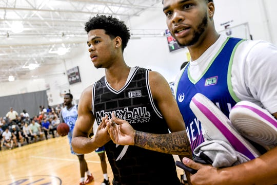 Michigan State freshman Malik Hall, left, shakes hands with former Spartan Miles Bridges before their Moneyball Pro-Am game on Thursday, June 27, 2019, at Aim High Sports in Dimondale.