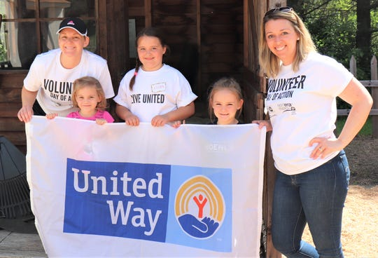 United Way Manitowoc County Executive Director Ashley Bender, right, with volunteers at Manitwooc County Historical Society during the annual Day of Action June 21.