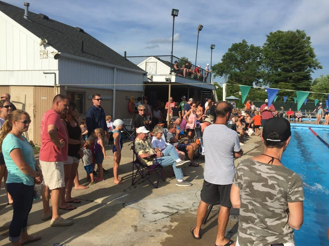 Friends and family members gather at Woodland Club on Wednesday for a dual swim meet between the host Eels and Walnut Hills.