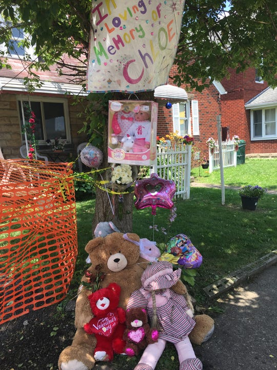 People leave toys and stuffed animals outside the South Foster Street home where 3-year-old Chloe Williams died early Wednesday morning in an arson-related fire that started in a vacant house next door.