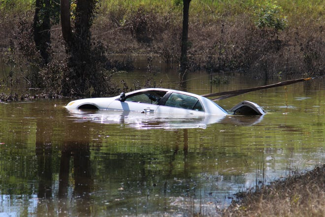 Buckeye Collision Service pulls a Honda Accord out of a pool of water Friday at Ohio 98 and the on-ramp to U.S. 23 north near Waldo after the car's driver lost control and went into the water.