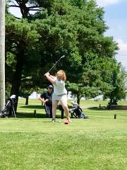 Rayma Smith tees off at the Heart of Ohio Junior Golf Association tournament at Kenton's Veterans Memorial Golf Course on Thursday.