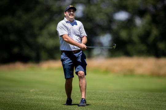Commercial Appeal columnist Mark Giannotto surveys his shot during the AutoZone Liberty Bowl charity golf tournament. He's grimacing because it likely wasn't a good shot.
